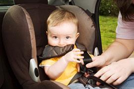 buckling baby into car seat
