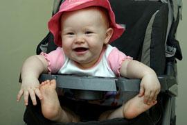 happy baby in stroller